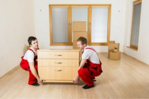 Movers moving a cabinet