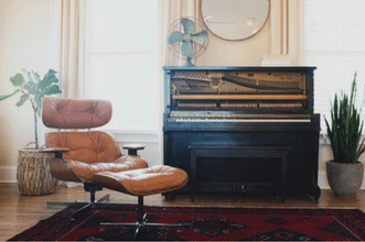 Precious piano and chair that require professional furniture movers